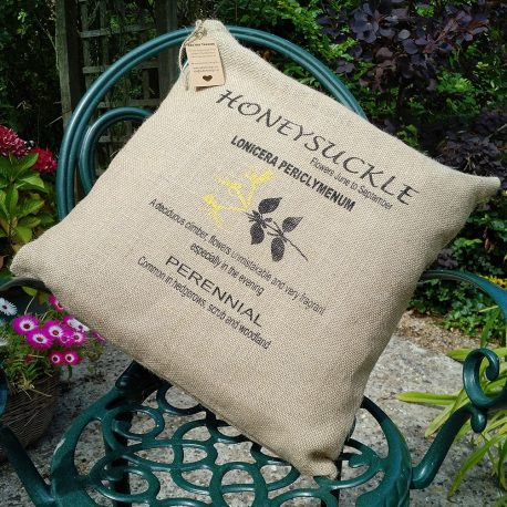 screen printed hessian cushion in two colours showing a honeysuckle design and text