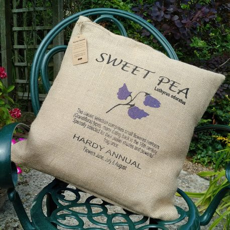 screen printed hessian cushion in two colours showing a sweet pea design and text about the sweet pea